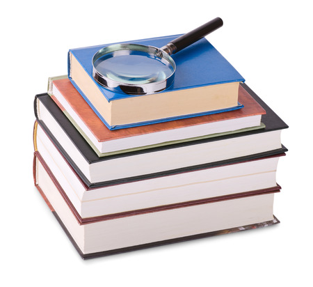 book reviews: Magnifying glass on stack of books isolated on white Stock Photo