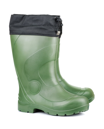rubber sole: Pair of green rubber boots isolated on white