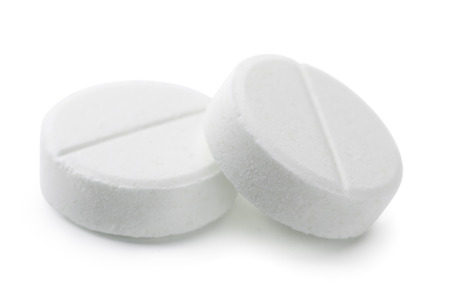 Pair of white pills isolated on white
