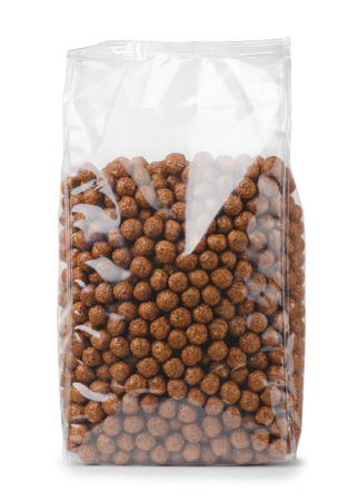 corn flakes: Plastic bag of chocolate cereals balls isolated on white