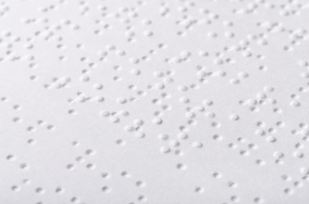 Close up of paper page  with braille text photo