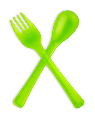 baby cutlery: Green baby fork and spoon isolated on white