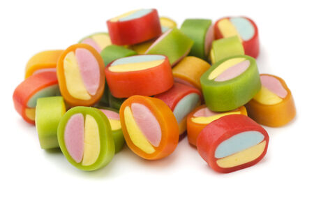 Pile of colorful gummy candies isolated on white photo