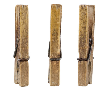 Three old wooden pegs isolated on white photo