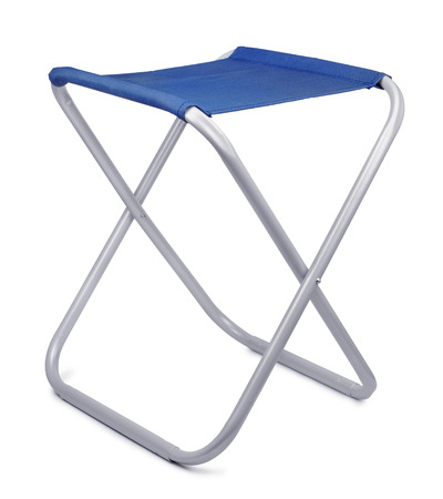 Folding camping stool isolated on white photo