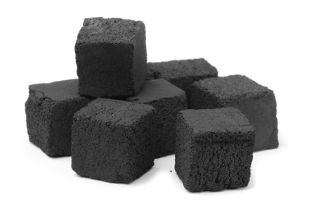 calorific: Group of charcoal cubes isolated on white