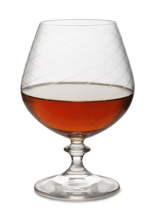 snifter: Snifter of aged brandy isolated on white Stock Photo