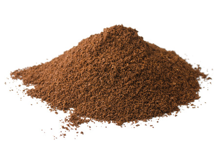 Pile of fresh ground coffee powder isolated on white photo