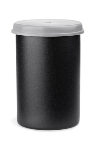 Black plastic film roll case isolated on white photo