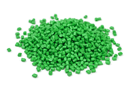 Pile of green polymer granules isolated on white Stock Photo