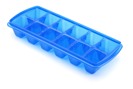 Blue plastic ice cube tray isolated on white photo