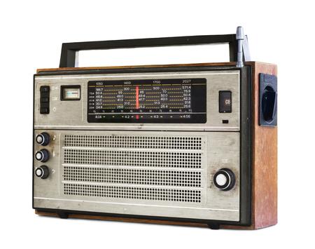 Old transistor radio isolated on white photo