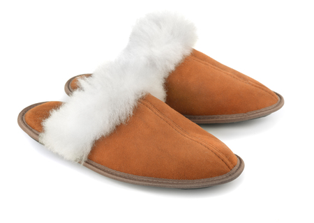 sheepskin: Brown sheepskin suede slippers isolated on white Stock Photo