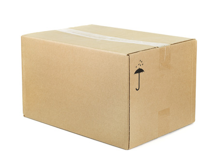 Closed cardboard box isolated on white photo