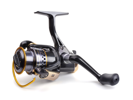 casting: Fishing reel isolated on white