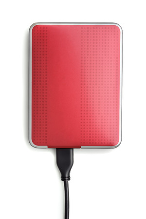 external hard disk drive: Red external hard disk drive isolated on white
