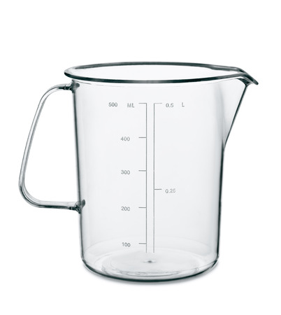 Empty kitchen measuring cup isolated on white photo