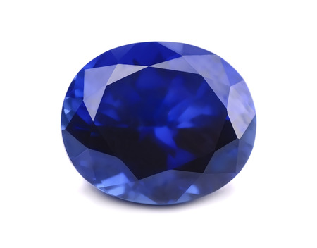 Natural sapphire gemstone isolated on white Foto de archivo