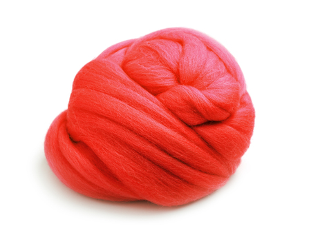 roving: Skein of red yarn staple fiber isolated on white Stock Photo