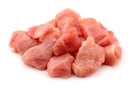 Raw fresh meat chunks isolated on white