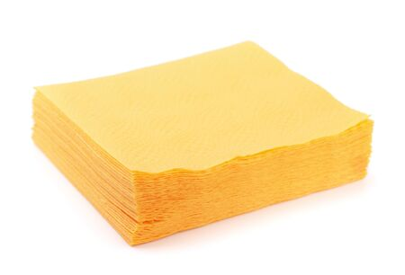 Stack of yellow paper napkins isolated on white photo