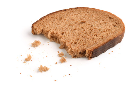 Slice of rye bread and breadcrumbs isolated on white
