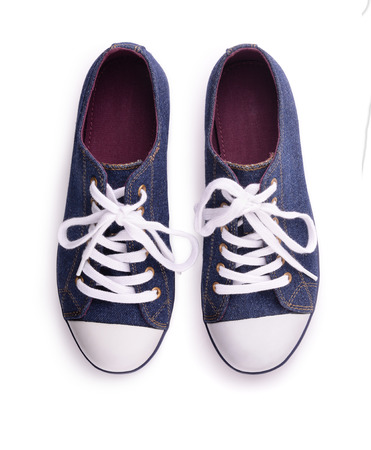 shoe laces: Top view of denim sneakers isolated on white