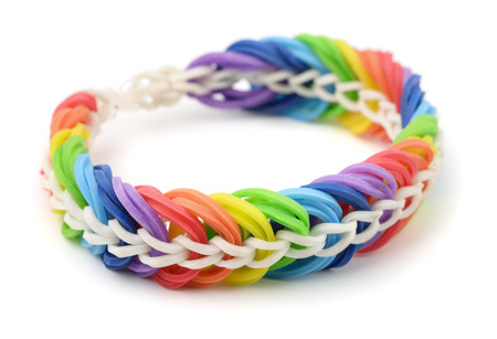 braided flexible: Rainbow rubber band bracelet isolated on white Stock Photo