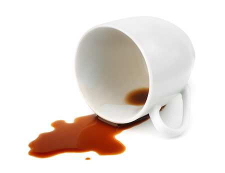 coffee spill: Fallen coffee cup with spilled coffee isolated on white