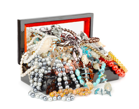 Open box full of jewelry isolated on white