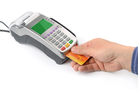 reader: Hand with credit card and credit card reader Stock Photo