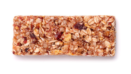 bar top: Muesli bar with fruits and nuts isolated on white