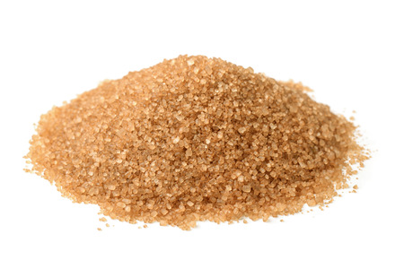 Heap of brown sugar isolated on white Imagens
