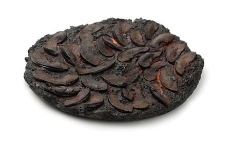 Burnt apple cake isolated on white Standard-Bild