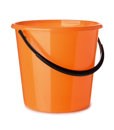 Orange plastic bucket isolated on white Imagens