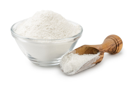 dry powder: Wheat flour in bowl and scoop isolated on white