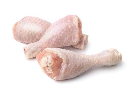 Fresh chicken drumsticks isolated on white