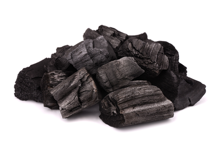 Pile of charcoal isolated on white Imagens