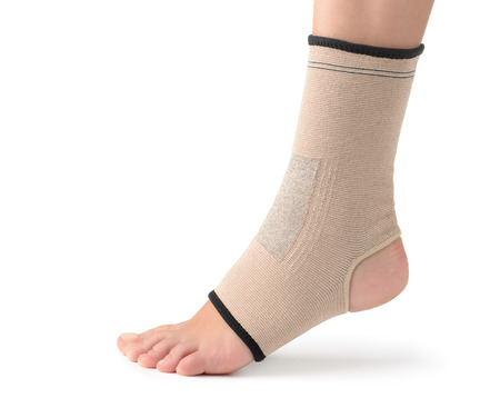 leg pain: Elastic ankle support isolated on white