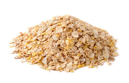 Heap of multi grain flakes isol;ayed on white Imagens