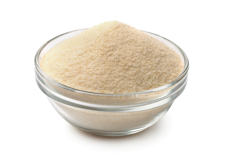 Bowl of semolina isolated on white Zdjęcie Seryjne