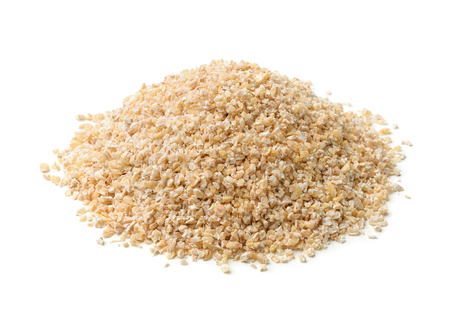 grits: Heap of barley grits isolated on white Stock Photo