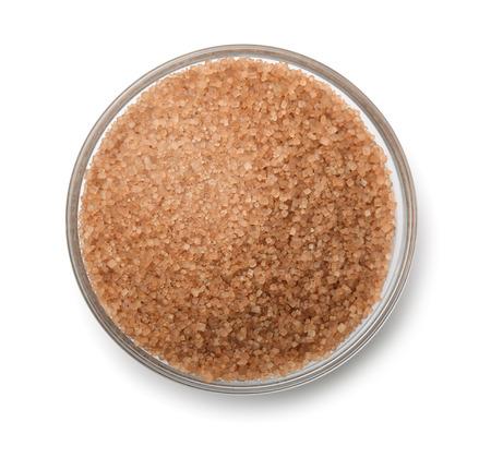 azucar: Vista superior de la taza de az�car de ca�a aislado en blanco Foto de archivo