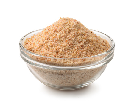 Bowl of breadcrumbs isolated on white