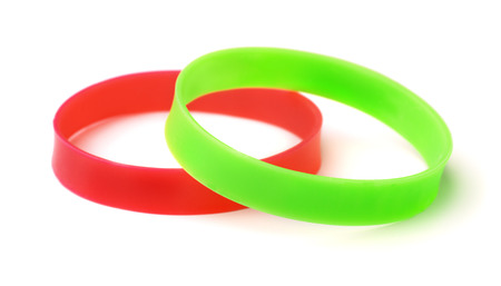wristbands: Two silicone wristbands isolated on white Stock Photo