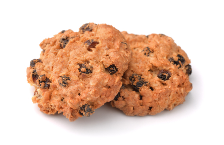 raisins: Oatmeal raisin cookies isolated on white