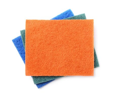orange washcloth: Top view of kitchen scourer pads isolated on white