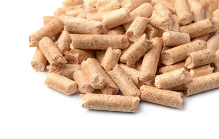 wood pellets: Close up of wood pellets on white background