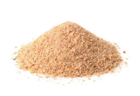 breadcrumbs: Pile of breadcrumbs isolated on white