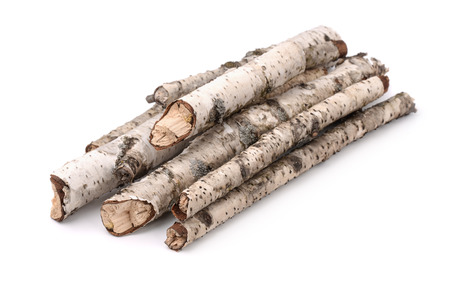 Pile of dry birch twigs isolated on white Foto de archivo